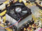 An OEM AMD heatsink mounted onto a motherboard.