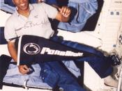 Astronaut Guy Bluford poses with a Penn State pennant onboard the Space Shuttle Discovery during mission STS-53. Bluford is a 1964 alumnus of the Department of Aerospace Engineering.