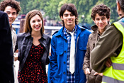The Jonas Brothers with Demi Lovato, photo shoot on the South Bank, London.