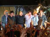 Toto on stage at the Summer Tour 2004 in Modena, Italy, July 11th 2004. From the left: Tony Spinner, David Paich, Bobby Kimball, Steve Lukather, Simon Phillips, Mike Porcaro
