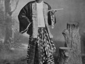 A man wearing a gaung baung typical of the style in the late 1800s.