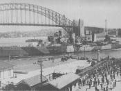 The Australian Leander class light cruiser HMAS Sydney coming alongside at Circular Quay in Sydney Harbour