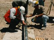 Exploration geologists examining a freshly recovered drill core. Chile, 1994