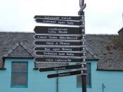 English: Signpost for pedestrian routes in Steornabhagh It's interesting to learn to read enough Gaelic to find one's way around in the Islands: it makes map-reading more enjoyable too, and the local people have helped with my attempts at pronunciation. (
