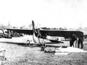 Clyde Cessna posing beside the silverwing
