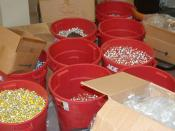 Several large buckets of anabolic steroid vials confiscated during a DEA raid