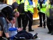 Ian Tomlinson after being pushed to the ground by police in London (2009). He collapsed and died soon after.