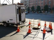 English: A fiber optic splice lab being used to access underground fiber optic cables for splicing.