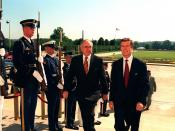 Australian Prime Minister John Howard (left) is escorted by US Secretary of Defense William Cohen (right), through an armed forces honor cordon into the Pentagon.