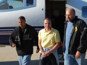 Juan Carlos Ramirez Abadia, escorted by two DEA agents after being extradited from Colombia.
