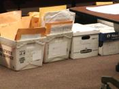 English: Boxes of challenged ballots sorted by county