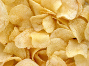 English: A pile of potato chips. These are Utz-brand, grandma's kettle-cooked style.
