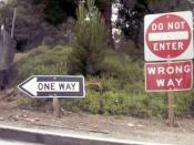 Standard wrong-way sign package used on all freeway off-ramps in California. This does not comply with the US Manual on Uniform Traffic Control Devices MUTCD Section 2A.18. Mounting Height. #section2A18 .