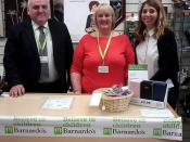 Roderick Campbell MSP and Anna Matthews, Barnardo's Works, join a volunteer at the shop