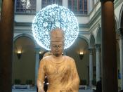 Statue of Maitreya (240 cm tall), sculpited during the chinese Empress Wu Zetian reign (625-705). The picture was taken at palazzo Strozzi in Florence, where the statue was placed during an exhibition on Tang Dynasty art. Behind the statue there is Artifi