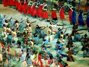 Aboriginal dancers make their way across the floor of the Olympic Stadium while performing before an audience of 110,000 during the opening ceremonies for the Sydney 2000 Olympic games.