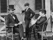 English: Ulysses S. Grant seated on porch with his wife, Julia, and son, Jesse.