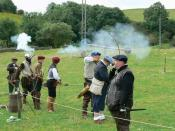 English: Practising their skill with arms Border Loons practise their skills with bow and musket.