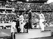 African-American Jesse Owens on the podium after winning the long jump at the 1936 Summer Olympics