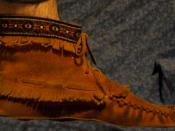 A soft-soled moccasin.