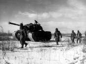 A column of troops and armor of the 1st Marine Division move through communist Chinese lines during their successful breakout from the Chosin Reservoir in . The Marines were besieged when the Chinese entered the Korean War November 27, 1950, by sending 20