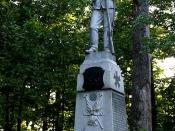 This is a photo of the Iron Brigade Monument in the Gettysburg National Military Park which is located in the vicinity where the Brigade first became engaged with the Confederate Army on the first day of the Battle of Gettysburg. Photo by Robert Swanson