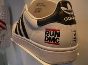 The Adidas shoe with the logotype ogа the hip-hop band Run DMC