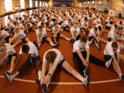 """English: Recruit Training Command, Great Lakes, Ill. (May 10, 2003) -- Recruits warm up before participating in the """"Captain's Cup"""" sports competition. The event has recruit divisions competing in several sporting events to win the RTC Olympic"""