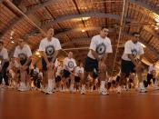 "English: Recruit Training Command, Great Lakes, Ill. (May 9, 2003) -- Recruits warm up before participating in the ""Captain's Cup"" sports competition. The event has recruit divisions competing in several sporting events to win the RTC Olympic"