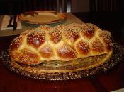 English: Six Braided Jewish Challah with sesame.