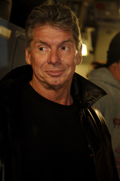 Vince McMahon, the Chairman of the Board of the World Wrestling Entertainment, Inc. boards a C-17 Globemaster III at Charleston Air Force Base, S.C. The 437th Aerial Port Squadron hosts the WWE stars and crew before a flight to Ramstein Air Base, Germany,