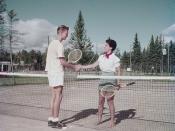 Grant Moore and Alex Groetaers shake hands on tennis courts at Waskesin, Prince Albert National Park, Saskatchewan / Grant Moore et Alex Groetaers se serrent la main sur le terrain de tennis à Waskesiu, au parc national de Prince Albert, en Saskatchewan