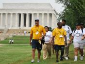 US Navy 090829-N-9268E-003 Capt. Cedric Pringle walks with students from historically black colleges and universities during the Historically Black Colleges and Universities National Health Walk