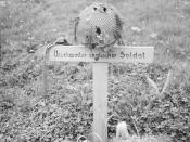 "THE BRITISH ARMY IN NORTH-WEST EUROPE 1944-45 The grave of a British airborne soldier killed during the battle of Arnhem in September 1944, photographed by liberating forces on 15 April 1945. On the cross is written in German ""unknown British soldier""."