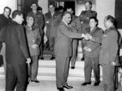 English: Egyptian President Gamal Abdel Nasser meeting Syrian delegation pushing for unity between Egypt and Syria. Nasser is shaking hands with Afif Bizri. To the left is Abdel Hakim Amer and next to him is Amin al-Hafiz