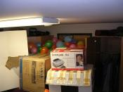 Practical jokes where balloons have been fitted between a door and a tower of boxes.
