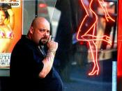 A bouncer in front of a strip club in San Francisco.