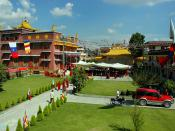 Based on the meditational deities palace, modern Tharlam Monastery, SUV (sports utility vehicle), motorcycle, Buddhist flags, courtyard, sunny day, Boudha, Kathmandu, Nepal