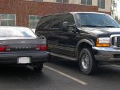 English: Toyota Camry (left) and Ford Excursion (right).