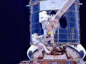 Astronauts work on installing Hubble's corrective optics during Servicing Mission 1.