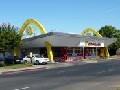 English: Historic McDonald's location: In July 1955, Ray Kroc (who had begun taking over the chain from the original McDonald's brothers) opened his own first sub-franchisee in Fresno at this location. The original structure was demolished for a contempor