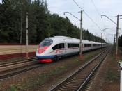 English: Russian Sapsan (Russian: Сапсан) high speed train (#155) passing Malino train station in Zelenograd, Moscow. This is the first high-speed train in Russia. The train is the same as ICE, but it goes slower than German ones; on this spot the speed w