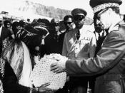 Photo of Shah distributing land deeds.