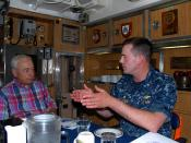 Former Secretary of the Navy John Dalton speaks with Cmdr. Brian Sittlow aboard USS Boise.