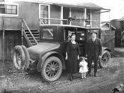 John Schafer with wife Neta Smith Schafer and daughter Bernice beside 1922 Buick Six automobile at railroad logging camp
