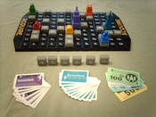 English: Photo of the board game Acquire in progress.