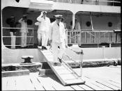 Captain P C Adelus of the Marine Nationale disembarking FR AMIRAL CHARNER