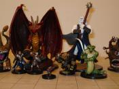 Several Dungeons & Dragons miniature figures. The grid mat underneath uses one-inch squares.