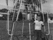 English: Boy in front of jungle gym