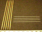 Double-pointed knitting needles, sometimes used for socks, collars and sleeves. Typically they come in sets of four or five; shown here are US size 8 in wood (left), and US size 1 in aluminum (right).
